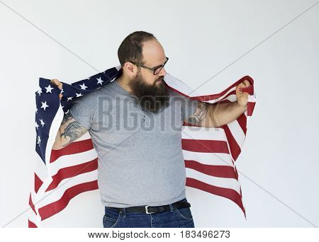 Adult Man Holding USA Nation Flag Studio Portrait