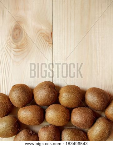 Fresh Kiwi Fruits On An Old Wooden Table
