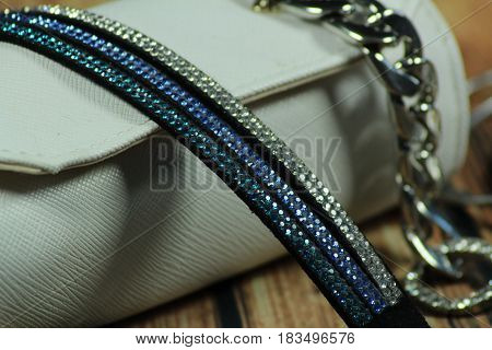 Women jewellery and white bag/ These are jewellery and travelling small bag.