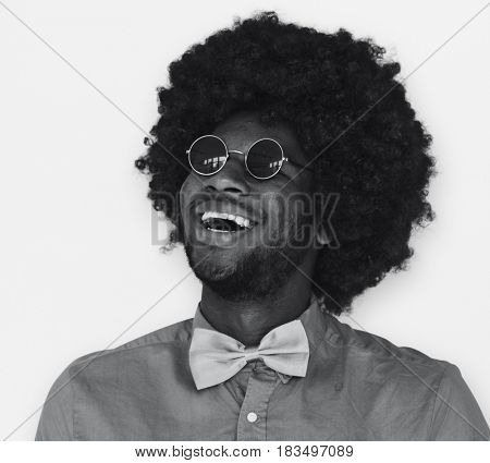 A Guy with a Black Afro Wig Smiling