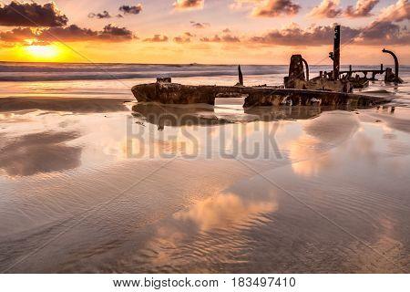 Sunken ship shot at sunset at Hof Dor, Israel.