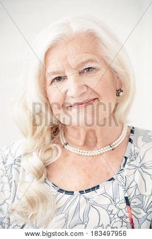 Portrait of a beautiful senior woman. Beauty, fashion. Happy retirement.