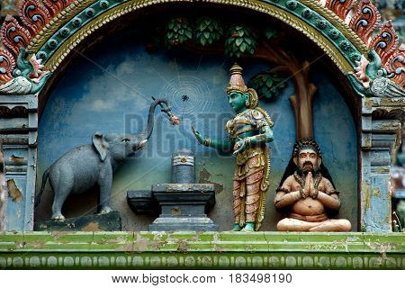 Icon of elephant offering rose flower to Lord Shiva at Jambkeshwara Temple in Tiruchirapalli Tamil Nadu India Asia