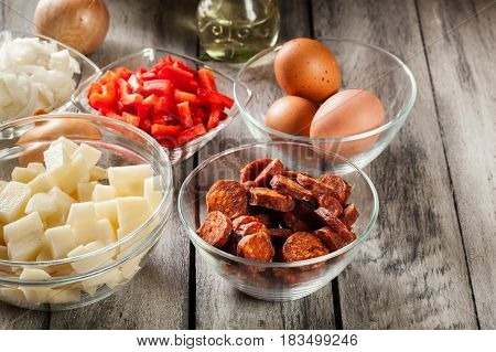 Tortilla De Patatas. Ingredients For Preparing Spanish Omelette With Sausage Chorizo, Potatoes, Papr