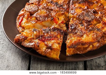 Tortilla De Patatas. Spanish Omelette With Sausage Chorizo, Potatoes, Paprika And Egg, Accompanied B