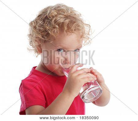 Little girl with a water glass