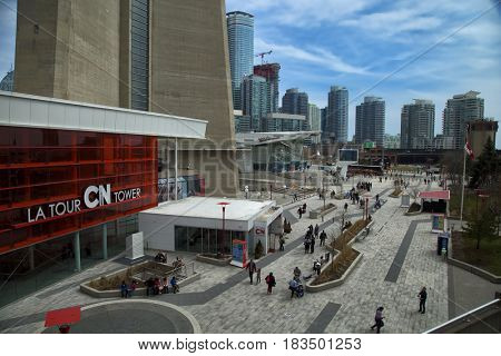 TORONTO-CANADA, 10 APRIL 2017:  View of the base of the 1,815.3 ft CN tower and Ripley's public aquarium of Toronto, Ontario