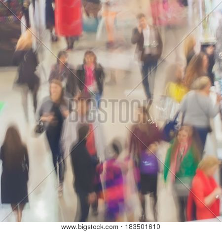 Abstract Large group of people, sales, walking in exhibition - trade fair show, blurred background