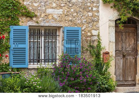 Window with shutters and old wooden door traditional house
