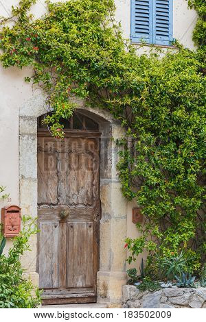 Traditional house with old wooden door, Alpes-Maritimes department, France