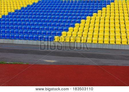 The rows of plastic chairs at new football  stadium