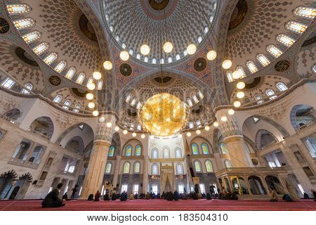 ANKARA, TURKEY - March 13, 2017: Kocatepe Mosque interior view during prayer.  The Mosque is the largest in Ankara and was built between 1967 and 1987.