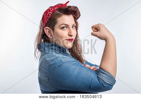 Young plus size pin-up brunette woman like classic We Can Do It poster isolated over white background.