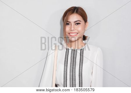 Portrait of fashionable asian businesswoman professional possibly accountant architect.