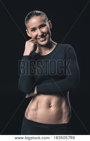 Young Fitness Woman Smiling And Posing Isolated On Black