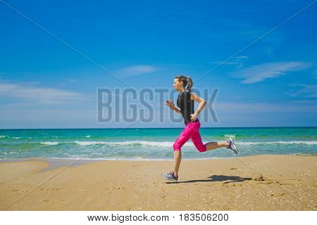 healthy lifestyle sports woman running on the beach