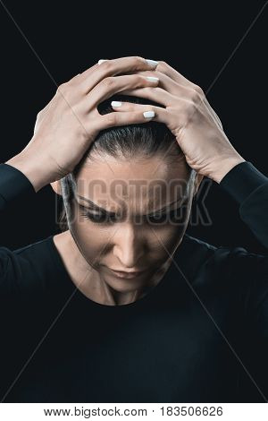 Front View Portrait Of Tired Young Woman Isolated On Black.
