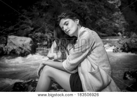 Young beautiful long hair woman portrait on forest river background