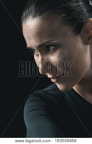 Side View Portrait Of Attractive Young Woman Isolated On Black.