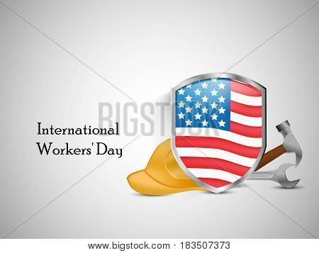 Illustration of shield with usa flag and hammer, spanner and helmet with International Worker's Day text