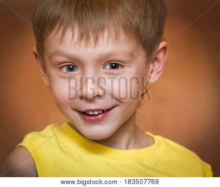 Little boy smiling close up emotional portrait