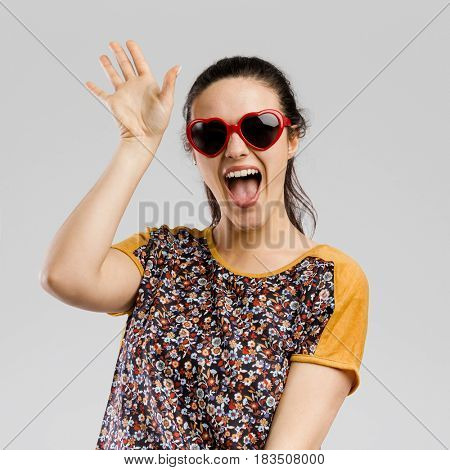 Portrait of Beautilful woman wearing sunglasses and say Hello