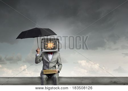 Man with TV instead of head . Mixed media