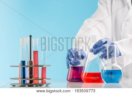 Experiments in a chemistry lab. conducting an experiment in the laboratory with humen hands