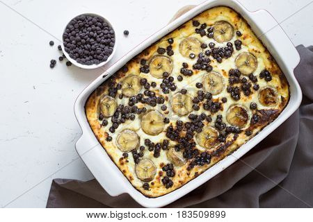 Cottage cheese casserole with banana and chocolate drops. Healthy breakfast or snack.