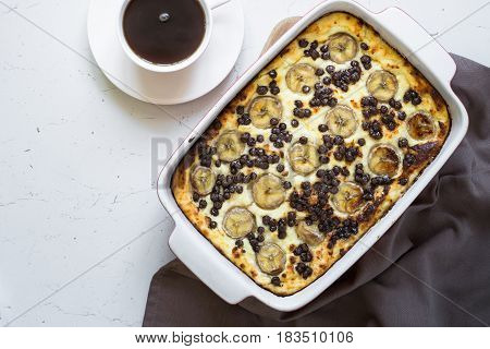 Cottage cheese casserole with banana and chocolate drops. Good for breakfast or snack.
