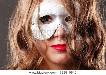 Holidays people and celebration concept. Woman with carnival venetian mask closeup