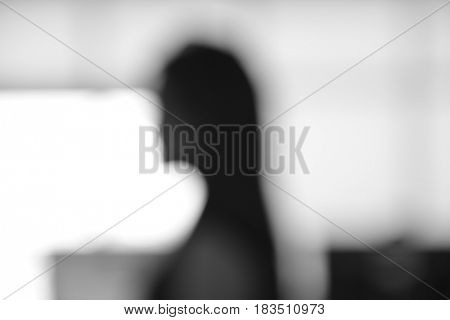 Abstract camera lens blur effect of a profile of a female. Black and white abstract background.