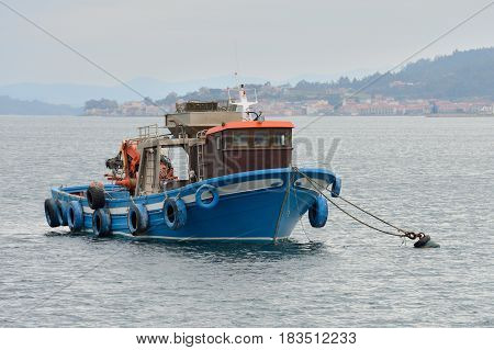 fishing boat tied up in the sea