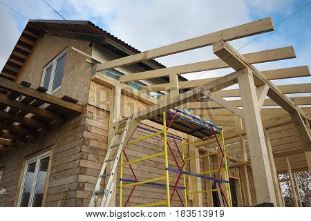Fragment New Home Roof Construction With Wooden House Frame, Country Village