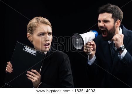 Angry Businessman With Loudspeaker Shouting On Colleague Isolated On Black