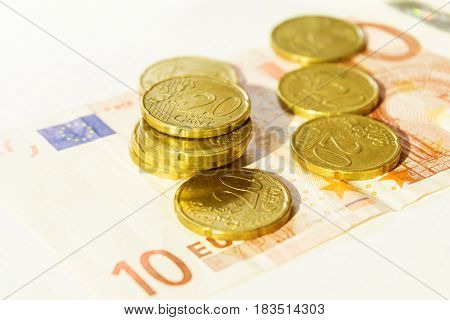 Cash with coins and currency on white background with toned shot
