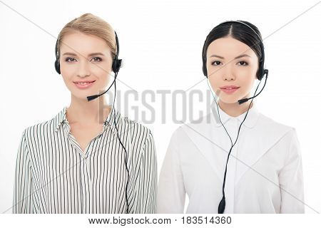 Portrait Of Call Center Operators In Headsets Isolated On White