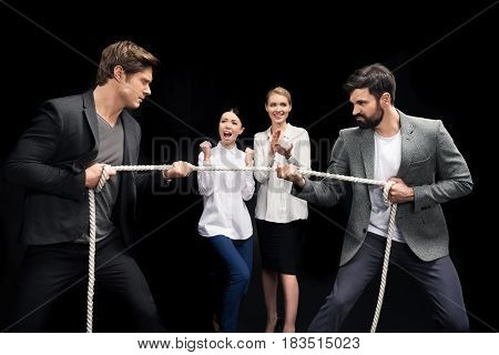 Businessmen Pulling Over Rope With Businesswomen Near By Isolated On Black