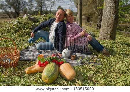 Portrait of an adult couple of man and woman on a picnic. Age of forty years. Ukraine. Europe.