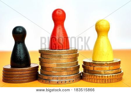 Money winner concept with game figures - close-up.