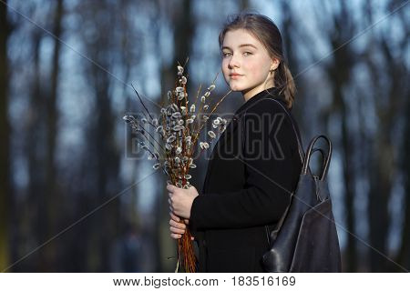 Emotional Portrait Of Young Happy Beautiful Woman With A Bouquet Of Pussy-willows Wearing Black Coat