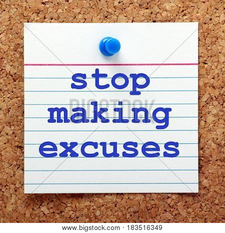 The words Stop Making Excuses in blue text on a note card pinned to a cork notice board as motivation