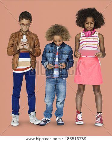 Children hold digital device together