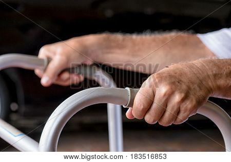 closeup elderly hands holding the walker, rehabilitation concept