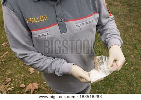 Salzburg Austria - April 16 2017: Lot Of Drugs Seized By  Austrian Police On Table With Weapons