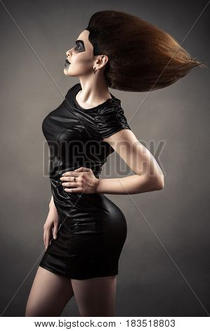 elegant sexy woman with lush hair isolated on gray background