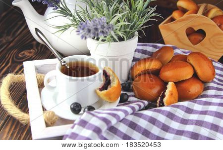 Breakfast in bed  with fresh buns and lavender