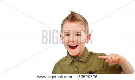 Portrait of attractive laughing boy, pointing finger, isolated on white background