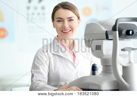 Young doctor sitting at table in medical office