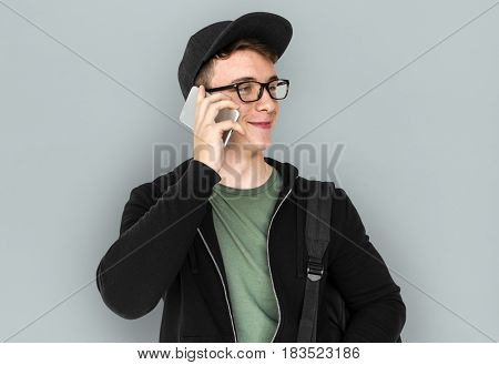 A teenager guy is on a phone